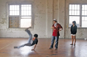 by: KATIE HARTLEY, Peter Chan tries out a few moves while other members look on. In break dancing, each person has an individual style, and teaching involves hints and pointers instead of actual choreographed moves.