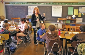 by: L.E. BASKOW, Sally Stephenson, a fourth- and fifth-grade teacher at Grout Elementary, leads a writing exercise with her students using tools she picked up at the Community of Writers workshop for teachers.