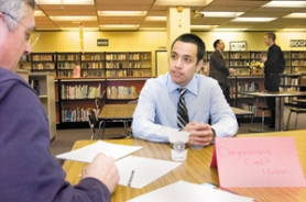 by: John Klicker, Nelson Gonzalez, 18, has a mock interview with Chuck Garner, CEO of Oregonians Credit Union, during Reynolds High's event Wednesday, April 16. Gonzalez did so well in the interview that he was encouraged to submit an application.