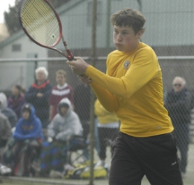 by: David Ball, Barlow's Chris Warren makes a backhand return during the Bruins' third-place victory in the No. 1 doubles bracket Saturday at the Portland Tennis Center.