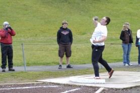 by: Darrell Jackson, Eric Anderson tosses the shot put. Anderson finished second in the event.