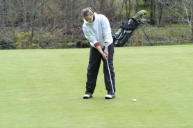 by: Darrell Jackson, Dalton Meade attempts to sink a put on the front nine during a recent Mount Hood Conference match.