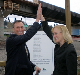 "by: submitted photo, Multnomah County Commissioner Jeff Cogen, left, and Clackamas County Commission Chair Lynn Peterson celebrate their signing of the ""Cool Counties"" initiative earlier this month."
