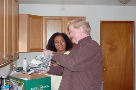by: Anthony Roberts, Teresa and Larry Walton unpack items in the kitchen of their new home off of Beavercreek Road.