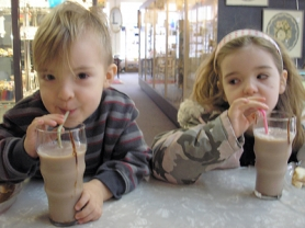 by: Ellen Spitaleri, Wiley Johnson, 2, and his sister Madison Johnson, 5, slurp up some chocolate milk at Main Street Soda inside the Milwaukie Collectors Mall on Main Street. Their mother, Melanie Johnson, said it was the first time she and the children had eaten at the old-fashioned soda fountain.