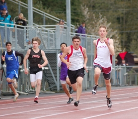 by: Kathy Storm, Nick Mulick sprints to the front of the pack during the 100 meters on Saturday.