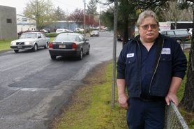 by: Jonathan House, BURNHAM BUSINESS — Bret Swopes, owner of Manning's Automotive Service, believes that the city of Tigard is trying to run his business, along with others, off of Burnham Street with a proposal to widen the streets and add bike lanes and sidewalks.
