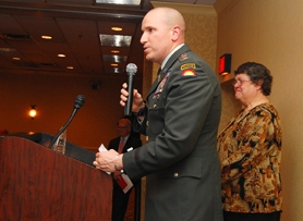 by: Darryl Swan, FIRST CITIZEN — Maj. Gary Repp, a plans officer with the 41st Infantry Brigade Combat Team, accepts the Tigard First Citizen award for the team.
