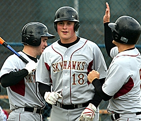 by: MILES VANCE, CELEBRATE — Southridge senior Jack Brock (center) is all smiles after hitting a home run in the second game of his team's doubleheader sweep of Aloha last week.