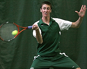 by: MILES VANCE, ON THE BALL — Jesuit senior Spencer Moore had his hands full in the Jesuit-Metro-State Team Tennis Championship — Moore took second in the first singles bracket.