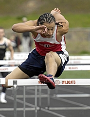 by: JOHN LARIVIERE, UP AND OVER — Westview's Richard Arnold clears the final hurdle on his way to victory in the 100-meter high hurdles against Southridge last week.