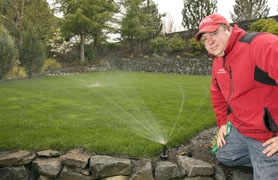 by: Jaime Valdez, Jim Lewis, owner of Lewis Landscaping, adjusts a water-efficient sprinkler head at a client's home in Beaverton, it sprays the lawn more evenly and wastes less water. Installing an efficient system also can get the homeowner a rebate in some water districts.