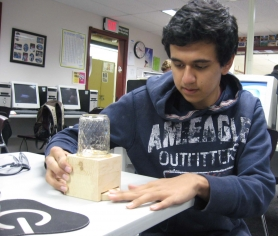 by: Kelly Moyer, A BETTER CANDY TRAP – Anthony Tahayeri, 16, a Sherwood High junior, demonstrates the candy dispenser he created using high tech engineering software and old-fashioned woodworking tools in his advanced Sherwood High shop class.