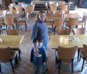 by: Kelly Moyer, IT'S A FAMILY AFFAIR — Shannon Hodney, owner of the new Hodney's Family Grille, stands in the renovated Old Town restaurant with her youngest son, Trent, 4. The new restaurant, located in the former home of Nottingham's in Old Town Sherwood, has turned a Sherwood landmark into a family friendly restaurant with home-style cooking with a separate sports pub.