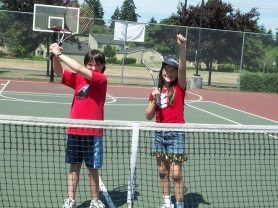 by: Contributed photo, GAME ON —Sherwood High School varsity tennis coach Yuki Sheehan, right, and Isobel Bailey celebrate after a tennis camp during last year's Summer Institute.