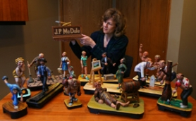 "by: COURTESY OF JULIE CIELOHA, Julie Cieloha shows off some of the woodcarvings made by friend James ""JP"" McDole. McDole left his carvings to Cieloha and other friends when he died in 2004."
