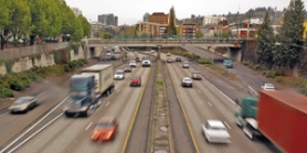 by: L.E. BASKOW, Afternoon traffic flows along Interstate 405. The City Council soon will vote on whether to move the old Sauvie Island Bridge to Northwest Flanders Street over I-405, despite the fact that four bridges already cross the freeway near there.