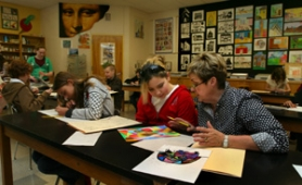 by: L.E. BASKOW, Liz Capps confers with student Marissa Garcia about a drawing Garcia is working on in a beginning intermediate art class at Sellwood Middle School. Capps is retiring from teaching there, and her art classes may go with her due to budget cuts.