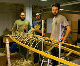 by: Rita A. Leonard, Looking in on the adult kayak-building class at Trackers NW. From left are students 