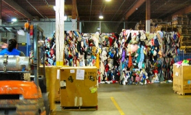 by: Elizabeth Ussher Groff, The activity on the floor at the Goodwill outlet recycling center on the south edge of Sellwood can be overwhelming, but makes possible the processing of hundreds of tons of goods each day