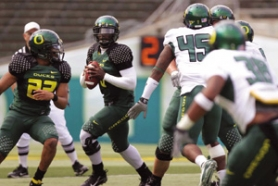 by: KATIE HARTLEY, True freshman QB Chris Harper stood out in spring ball for the Ducks with his speed and strong arm.