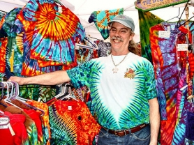 by: Merry MacKinnon, Eric Nykanen of Sellwood sells most of his colorful line of tie-dyed apparel at Saturday Market, where sales are brisk. After moving here from California, Nykanen discovered a ready market for his tie dye clothing line.
