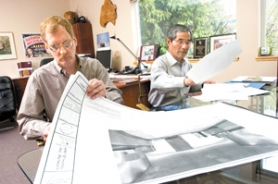 by: John Klicker, RIch Palmer, left, project manager of HM-3 Ethanol, goes over design plans for a cellulose-based ethanol lab with company President Hiroshi Morihara at his Persimmon Realty office.