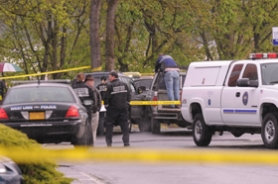 by: VERN UYETAKE, West Linn Police cordon off an area in the police department parking lot where a man shot and killed his estranged wife, before turning the gun on himself. The wife died at the scene; the husband died later at an area hospital.