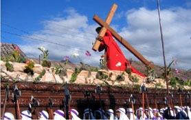 by: Sandra Kennedy, Christ carries his cross on a 5,000- to 6,000-pound float, or anda, which is carried through the streets of Antigua.