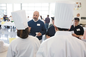 by: Chase Allgood, Al Rogers (center), principal of Tom McCall Upper Elementary School, judged entries in last Friday's culinary competition.