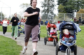 by: Shasta Kearns Moore, Noelle Johnson runs back down a slight hill after slaloming through baby strollers during a Baby Boot Camp session at Gabriel Park.