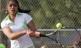 by: MILES VANCE, SHE'S READY — Jesuit freshman Sanjana Rao smacks a return in her match against Sunset on Friday.