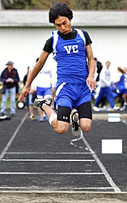by: JONATHAN HOUSE, CATCHING AIR — Valley Catholic's Mason Dunlop takes off during the triple jump last week.