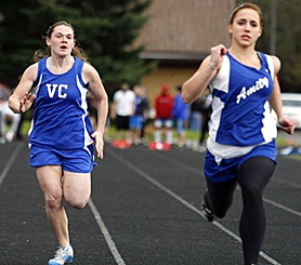 by: JONATHAN HOUSE, GIVING HER ALL — Valley Catholic senior Nicole Hardisty races through the 100 meters last week during her team's home invitational meet.