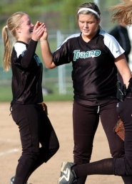 by: DAN BROOD, GOOD JOB — Tigard freshman second baseman Maddie Miller (left) is congratulated by pitcher Ashley Suter after making a juggling catch in the third inning.