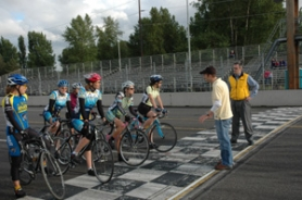 by: ©2007 Jim Anderson, Pedal-powered racers gather at the starting line at Portland International Raceway, where they're a little quieter than what usually circles the track.