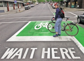 by: JIM CLARK, Cyclist Ryan Conrad is one of two Portlanders challenging the city's quest for federal approval of its bike box design. He and other critics say their safety and utility haven't been proven.