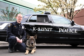 by: Submitted photo, NEW SLUETH POOCH — Tigard Officer Brian Jackson and Baxter, a German Shepherd male bred in Eastern Europe, make up the city's new K-9 patrol, the first in nearly a decade.