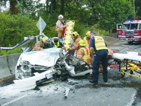 by: contributed photo, Boring's extrication team works quickly to pull people from the mangled wreckage of crashed automobiles.