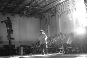 by: garth guibord, Sandy High School teacher Bruce Scarth addresses the student body during the
