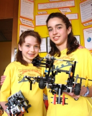 by: Jennifer Clampet, A GENERIC DESIGN – (From left) Sisters Tesca and Taytlyn Fitzgerald, of Tigard, will head to the International Intel Science and Engineering Fair in Atlanta, Ga., in May.