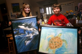 by: Jonathan House, UNDERWATER ADVENTURE — (From left) Andrea Fisher, 16, and Sterling Mier, 7, both took first place in their grade levels in a national Wyland-sponsored art contest. Now, the students have a chance to travel to China in August to work with the renowned artist at the summer Olympics.