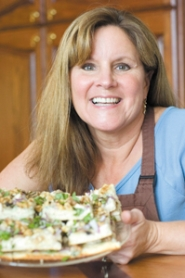 by: John Klicker, Kathy Sepich displays her Chicken Alfredo Gorgonzola-Walnut Pizza, which made it into the top 100 recipes in the Pillsbury Bake-Off® contest this year. Sepich was flown to Dallas, Texas, to compete for the top, million-dollar grand prize.
