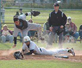 by: John Brewington, St. Helens' Julian Zirkle is safe at home during game with Glencoe on Thursday. The Lions lost their first game with the No. 2-ranked Crimson Tide, but came back to win the next two games and the series.