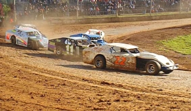 by: Lori Holmason, Greg Greer takes a turn during Modified Division race at River City Speedway.