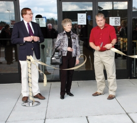 by: Art Heerwagen, Theater owner Chuck Nakvasil (left) helps Scappoose Mayor Scott Burge (right) and Councilor Donna Gedlich cut the opening ribbon at a pre-opening celebration held at the seven-screen facility on Wednesday, April 30.