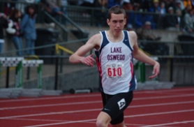 by: Matthew Sherman, Lake Oswego's Elijah Greer crosses the finish line after winning the 800m at last week's state track meet.