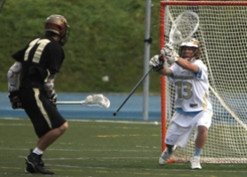 by: John Hoch, Goalie Warren Nielson makes a stick save in last week's narrow victory over Southridge. Nielson, playing in place of injured Jonny Internicola, had another solid game as Lakeridge advanced to the semifinals.