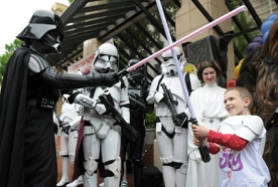 by: Matthew Ginny, Lake Oswego's Owen Miller takes on Darth Vader with his new light saber last week at Pioneer Place in Portland as part of the Make-A-Wish Foundation's kick-off event in Oregon. In addition to the light saber, Owen also was given a full Stormtrooper uniform. The Miller family soon will depart to Disney World in Florida for a special Star Wars vacation. The Star Wars characters are from Cloud City Garrison, a local chapter of the 501st Legion of Stormtroopers.