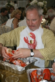 by: J. Brian Monihan, Lake Oswego City Manager Alex McIntyre gets ready to enjoy one of the many fine lobsters served Saturday night.